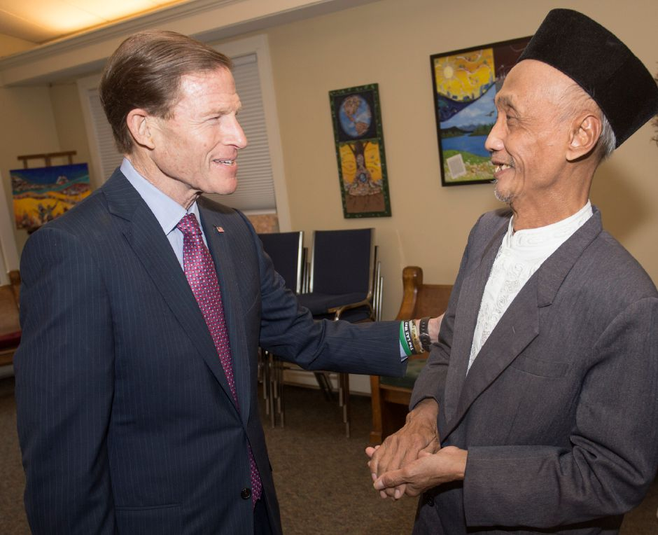 U.S. Sen. Richard Blumenthal, left, greets Sujitno Sajuti, of West Hartford, who has taken sanctuary at the Unitarian Universalist Church on Paddock Avenue in Meriden. The church held a roundtable discussion on immigration with Blumenthal Wednesda Nov. 22, 2017. | Richie Rathsack, Record-Journal staff
