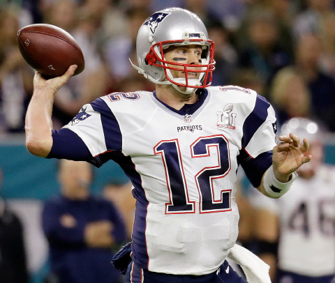 FILE - In this Feb. 5, 2017 file photo, New England Patriots quarterback Tom Brady prepares to pass against the Atlanta Falcons during the first half of the NFL Super Bowl 51 football game in Houston. Tom Brady