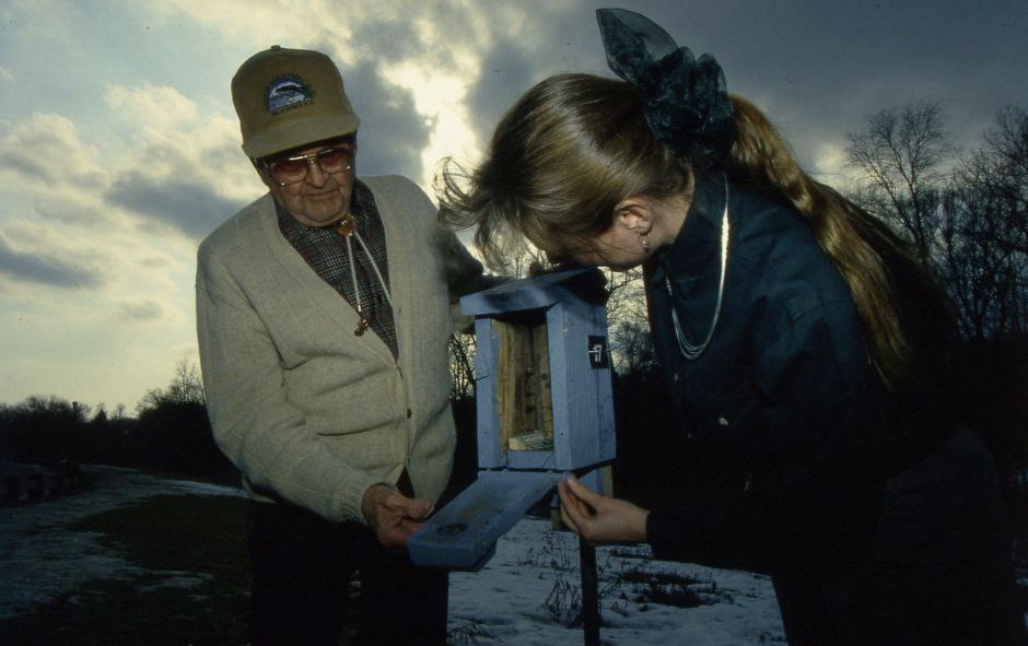 RJ file photo - Charlie Eisenhauer, a resident at Ashlar Village in Wallingford, shows the bluebird house he built to state wildlife biologist Jenny Dickson. Residents are trying to help restore the state