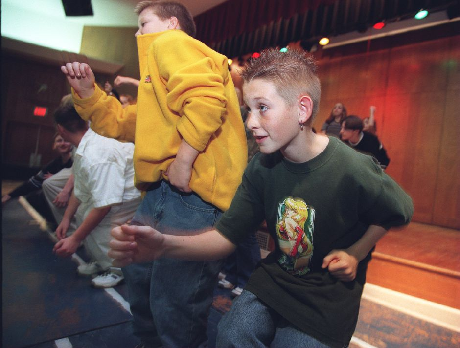 RJ file photo - C.J. Pulaski, 13, and other Lincoln Middle School eighth-graders dance at a workshop held by the Goodspeed Opera House choregrapher Dec. 4, 1998.