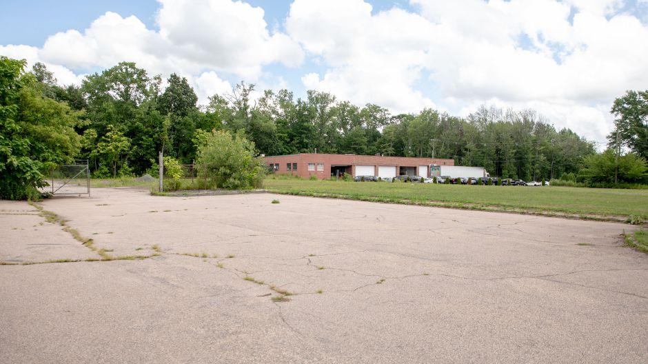 The former site of Pioneer Precision Products at 889 Farmington Avenue in Berlin is planned to become the site of a new five-building development connected to the adjacent train station.