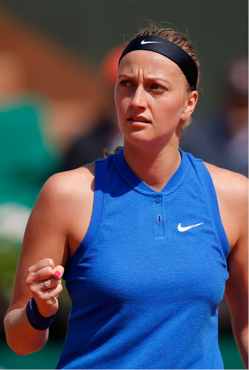 FILE - In this May 25, 2016 file picture Petra Kvitova of the Czech Republic reacts as she plays Taiwan