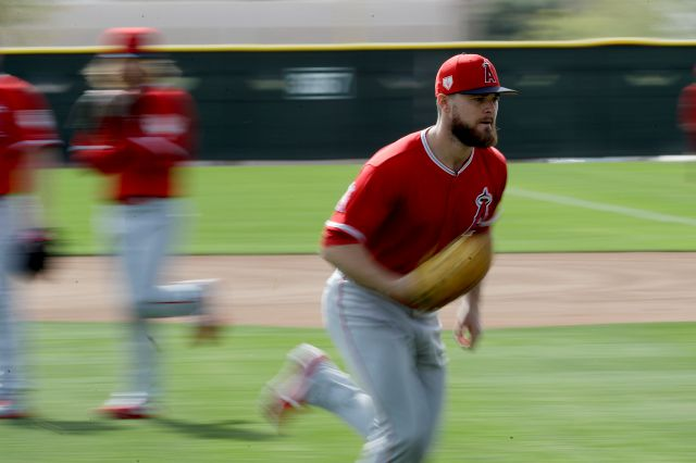 In this image taken with a slow shutter, Los Angeles Angels Jared Walsh runs during a drill at spring training baseball in Tempe, Ariz., Friday, Feb. 15, 2019. (AP Photo/Chris Carlson)
