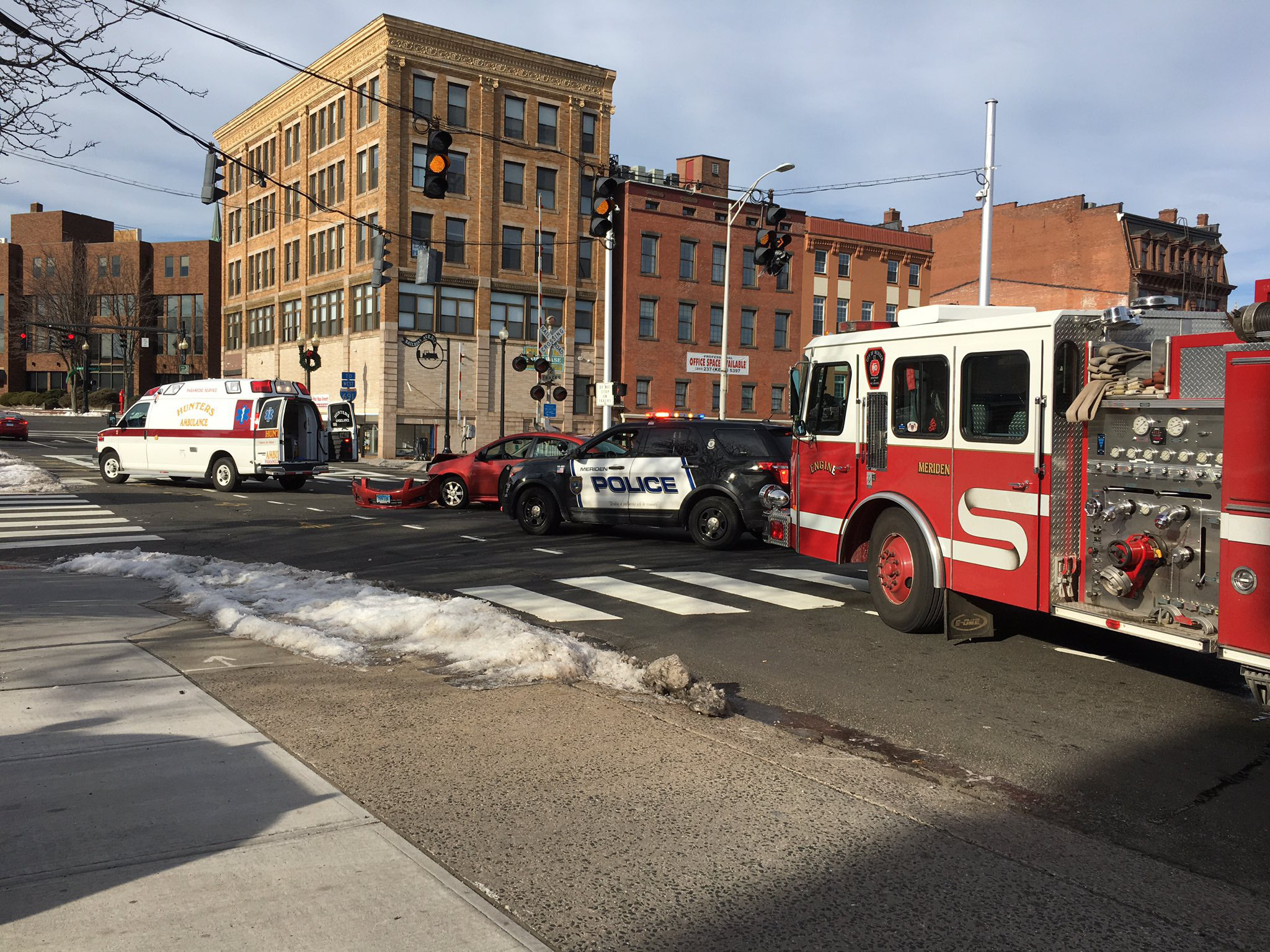 A car and bus collided at the intersection of East Main and State Streets on Monday. | Lauren Takores, Record-Journal