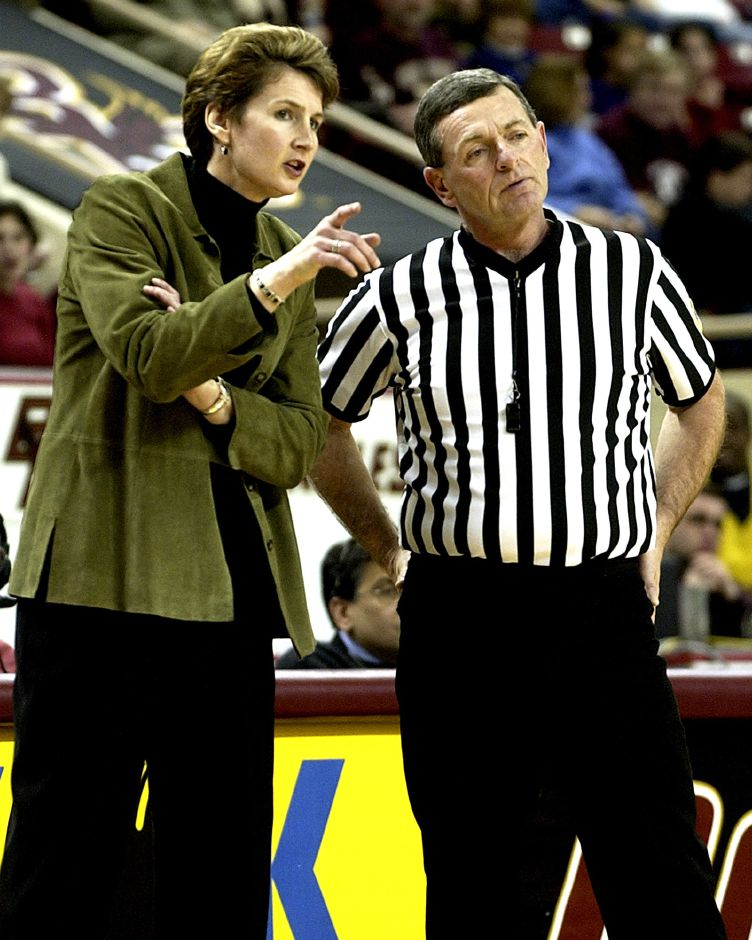Boston College coach Cathy Inglese, left, tries to make a point with one of the officials during Boston College