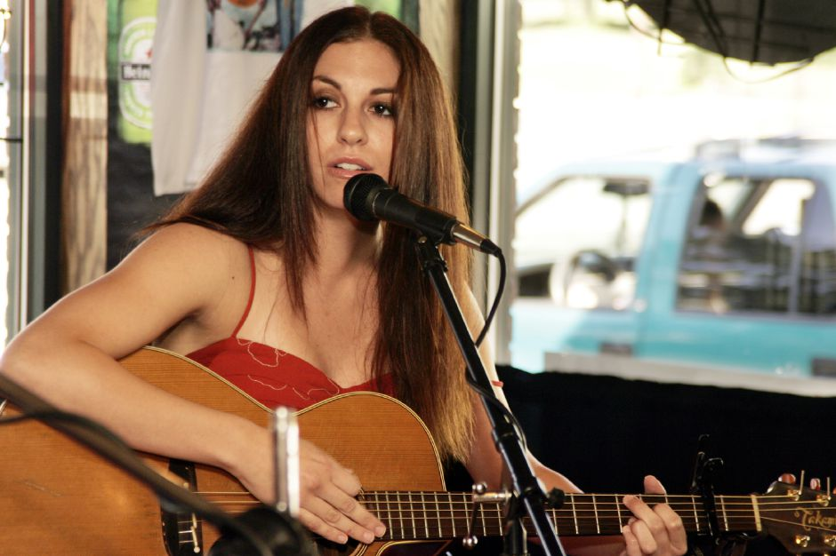"Jenna Duval, of Bristol, performs at the Pigout BBQ on Eden Ave. Sat., Aug. 14 during their ""Pigstock"" event."