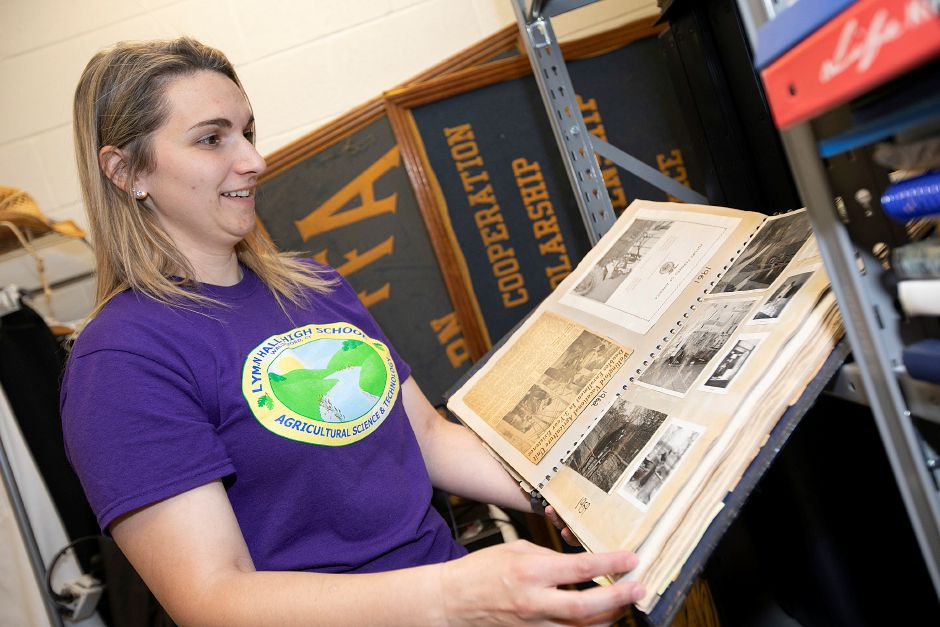 Agricultural science teacher Kathryn Dal Zin looks through the first Future Farmers of America Official Scrap Book Lyman Hall Chapter at the school on  Tuesday. Dave Zajac, Record-Journal