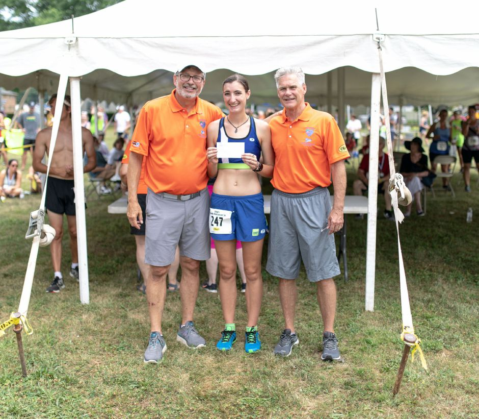 Elizabeth Mashiak, of Newington, poses with William Petit Jr., left, and Bob Heslin, right, after being the fastest in her age bracket during the Chips Family Restaurant Road Race on July 21, 2019. The run started on East Street in front of Plainville High School and ended on Robert Holcomb Way. | Devin Leith-Yessian/Plainville Citizen