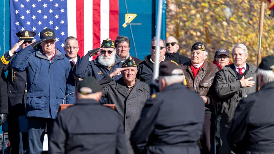 Veterans and city officials salute during Meriden