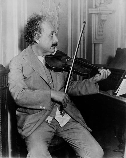 The file photo from August 23, 1944 shows Dr.Albert Einstein playing violin in his study. (AP Photo)