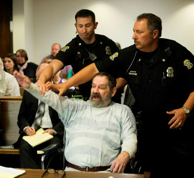 FILE - In this Nov. 10, 2015, file photo, Frazier Glenn Miller Jr., convicted of capital murder, attempted murder and other charges, gestures as Johnson County deputies remove Miller from the courtroom during the sentencing phase of his trial at the Johnson County District Court in Olathe, Kan. A recent Kansas Supreme Court ruling declaring that the state constitution protects access to abortion has opened the door to a new legal attack on the death penalty. Attorneys for five of the 10...