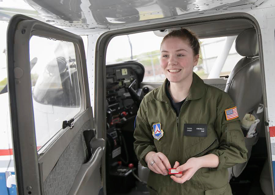 Olivia Cretella, 17, of Plainville, poses next to a Cessna 172 in May before a flight at Meriden Markham Municipal Airport. | Dave Zajac, Record-Journal