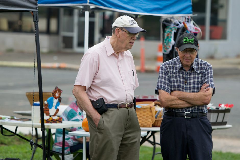 Peter Burch left and Edgar Marotti both of Meriden talk Saturday at the Meriden Farmers Market on the Meriden Green in Meriden October 7, 2017 | Justin Weekes / For the Record-Journal
