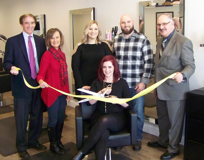 Mayor William Dickinson, Dee Prior-Nesti, executive director Quinnipiac Chamber of Commerce, Danielle Medeiros, stylist, Nolan Masse, Joe Mirra, chairman of the Economic Development Commission; seated: owner and stylist, Kate Masse.