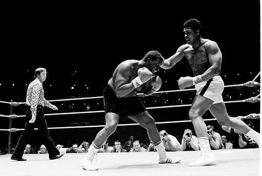 Muhammad Ali lands a hard blow to the head of Buster Mathis during the fifth round of their 12-round fight in Houston, Tex., Nov. 17, 1971. (AP Photo)