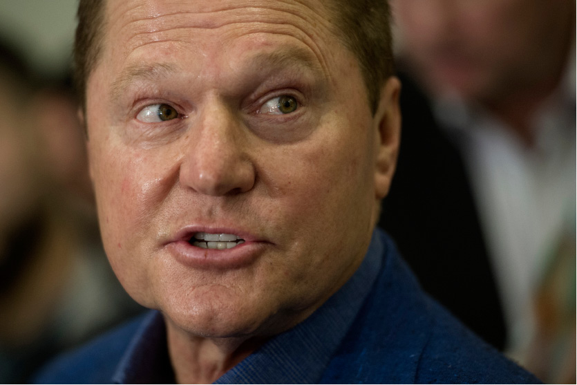Sports agent Scott Boras responds to a question from the media during Major League Baseball