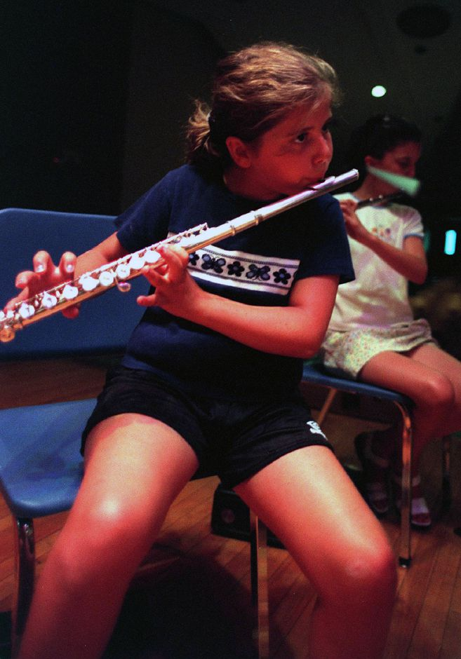 "Laura Mesite, 10, from Wallingford is playing her part in ""Star Wars"" during band practice at Moran Middle School Summer Camp, Aug. 1999."