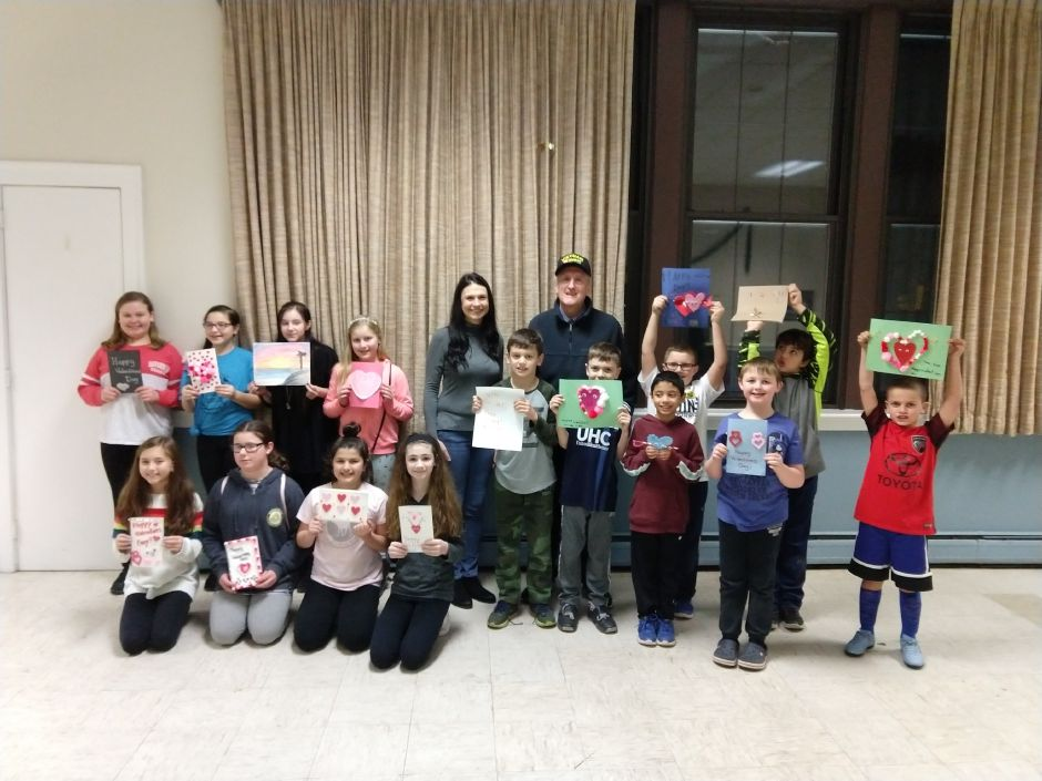 Local youngster Liam Gauvin and a group of his friends create Valentine's Day cards for veterans.