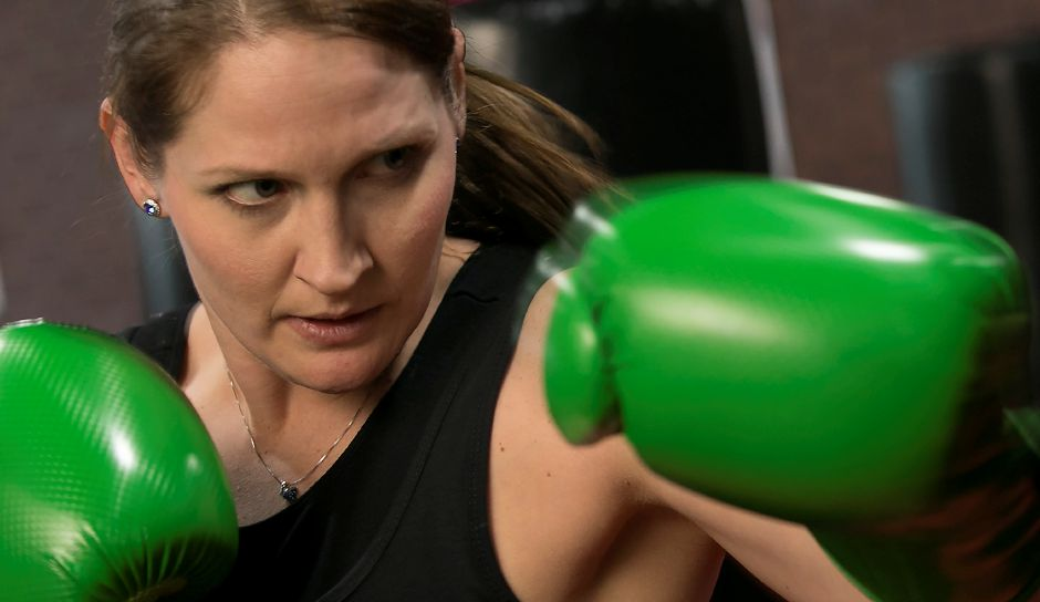 Danielle Trubia, manager/instructor, works out on the bag at iLoveKickboxing, 99 Executive Boulevard in Southington, Thursday, Feb. 15, 2018. Dave Zajac, Record-Journal