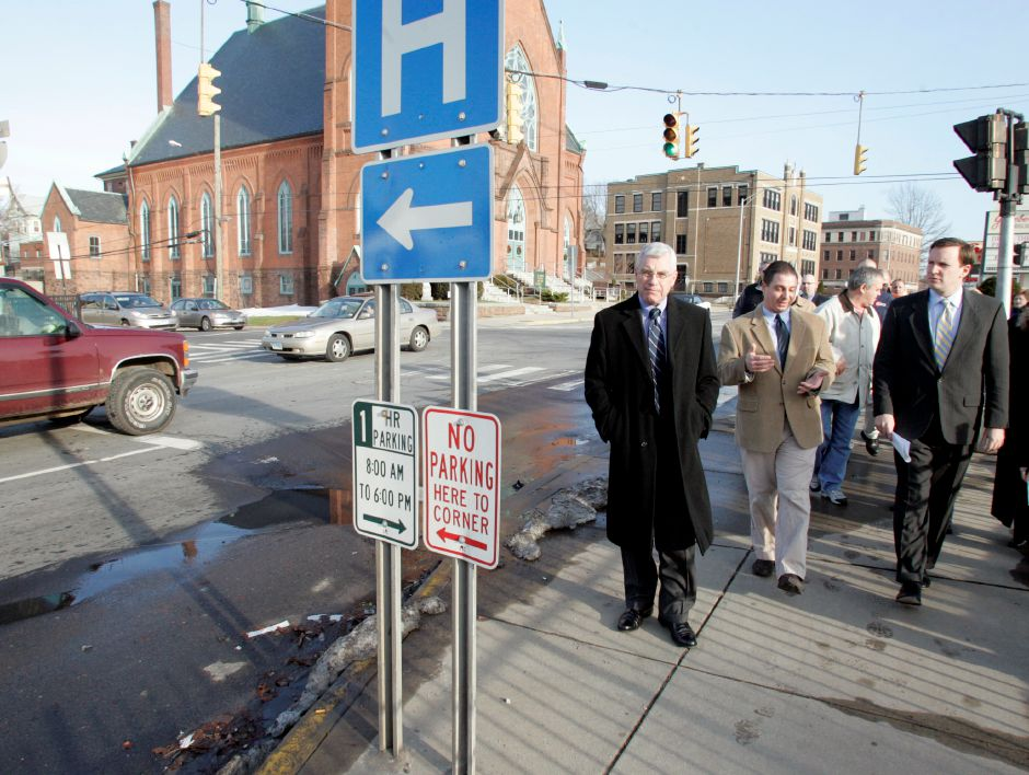 From left George McGoldrick, Mayor Mark Benigni, and Congressman Chris Murphy walk down West Main St. in Meriden, Friday, Dec. 28, 2007. Murphy secured money for the improvements along West Main St. including sidewalks, lighting, and other landscape improvements.