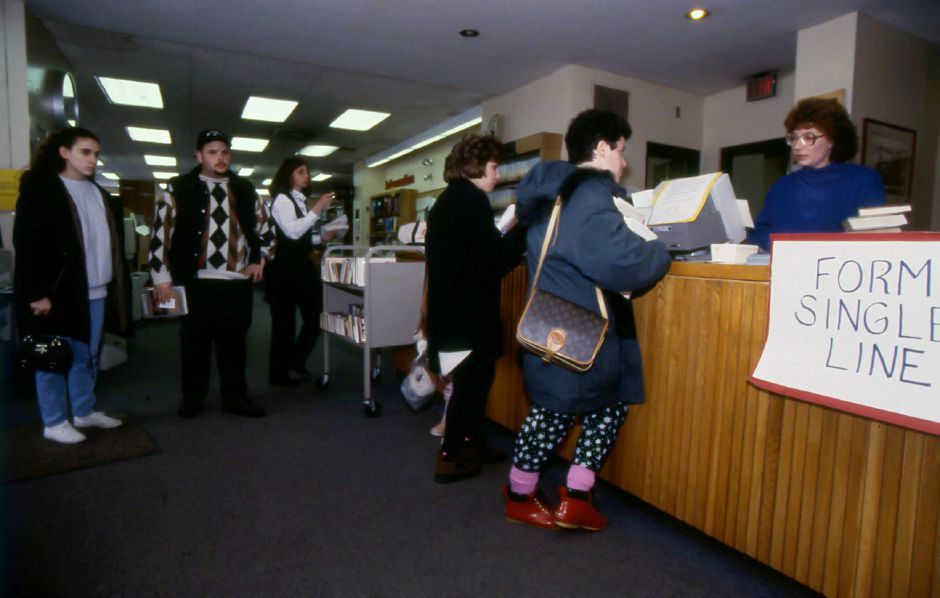 RJ file photo - Conditions at the Cheshire Public Library force patrons to wait in crowds rather than lines, Feb. 12, 1994.