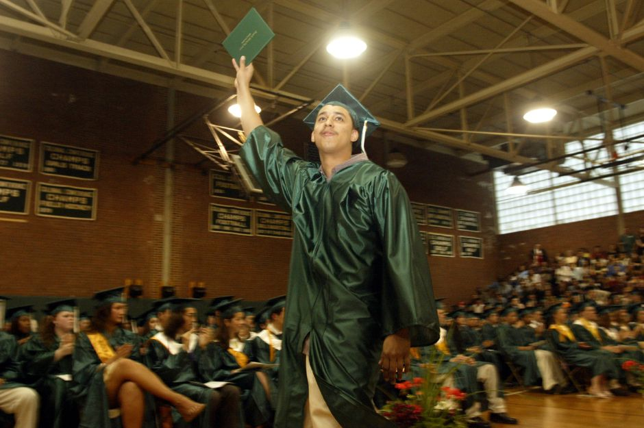 Jose A. Aldea shows off his diploma to the crowd during the Francis T. Maloney High School graduation Friday evening.
