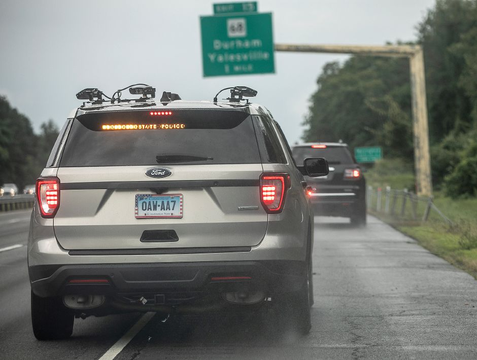 State Trooper Joshua McElroy pulls over a motorist on Interstate 91 in Wallingford after license plate readers alerted of an expired registration, Fri., Aug. 23, 2019. Dave Zajac, Record-Journal