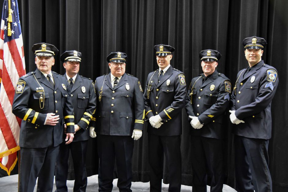 North Haven Police Chief Thomas J. McLoughlin (left), Deputy Chief Kevin Glenn, Captain Stanley Lofquist, Lt. Matthew Falcon, Sgt. Christopher Spose, and Sgt. John Gaspar pose for a picture after a swearing in ceremony. The four policemen on the right were promoted during the board of police commissioners meeting at the North Haven Middle School on Jan. 15, 2019. | Bailey Wright, Record-Journal