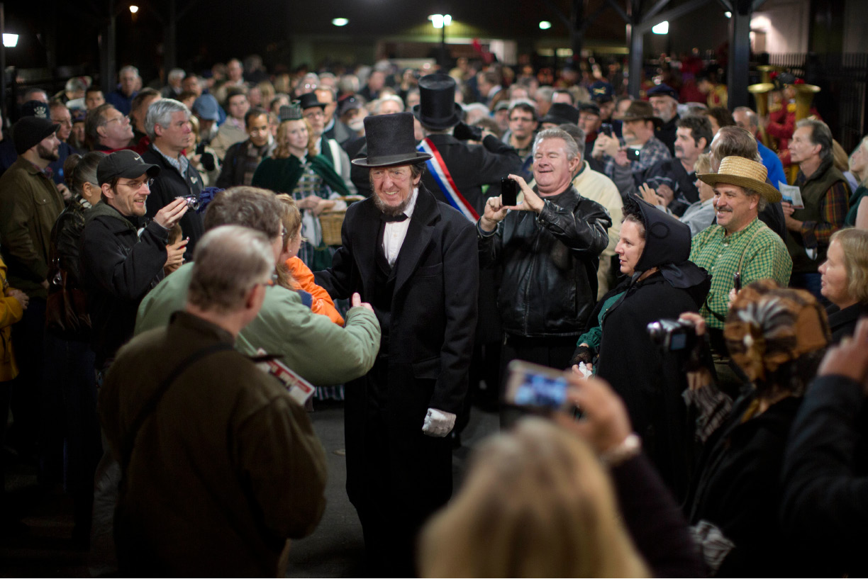 President Abraham Lincoln, portrayed by presenter Robert Costello, is greeted Monday, Nov. 18, 2013, at the Gettysburg Train Station in Gettysburg, Pa. Tuesday, Nov. 19, marks the 150th anniversary of Lincoln