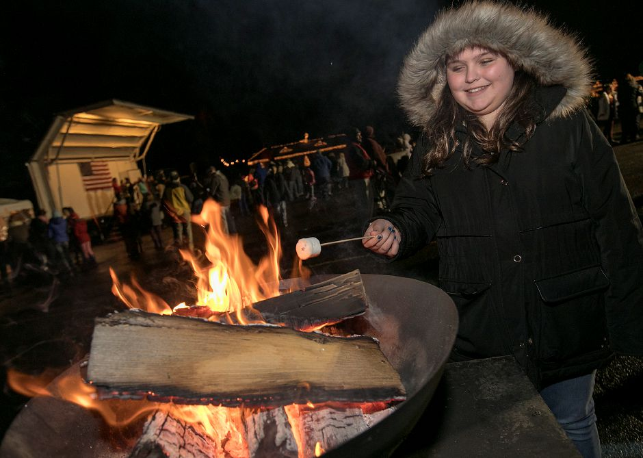 Samantha Wiley, 13, of Meriden, roasts a marshmallow while making s