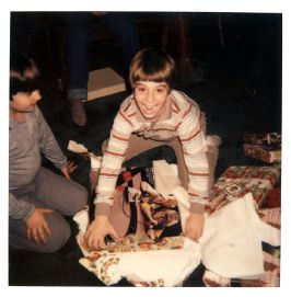 Mark Benigni opening up Christmas presents when he was 9 years old. Courtesy of the Benigni family.