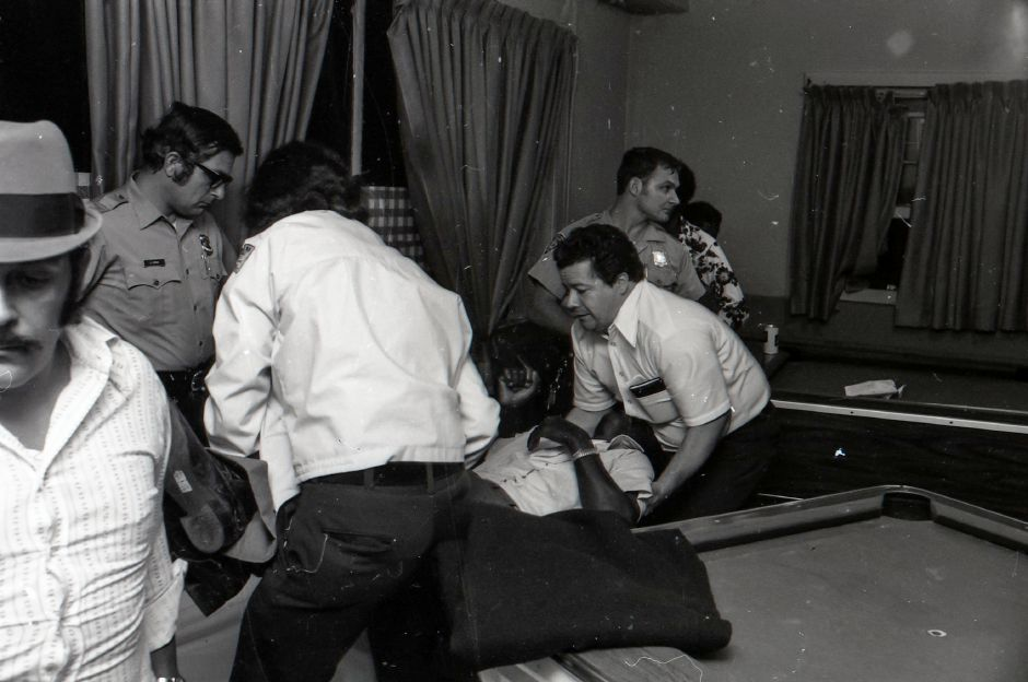 Police respond to a stabbing at a Pratt Street pool hall, March 1975.