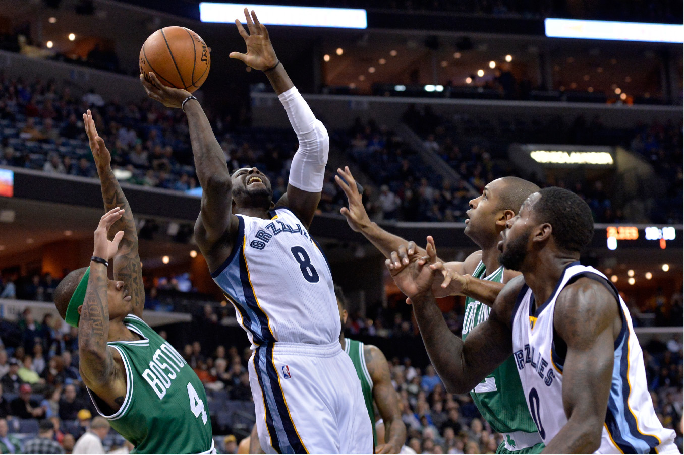 Memphis Grizzlies forward James Ennis (8) shoots between Boston Celtics guard Isaiah Thomas (4), Celtics center Al Horford, second from right, and Grizzlies forward JaMychal Green (0) in the first half of an NBA basketball game, Tuesday, Dec. 20, 2016, in Memphis, Tenn. (AP Photo/Brandon Dill)