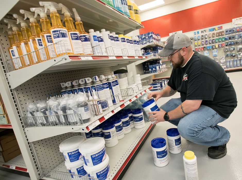 Chris Arsenault, sales rep., stocks shelves at the new F.W. Webb Company at 30 Pomeroy Ave. in Meriden, Friday, June 28, 2018. The store is open weekdays 6:30 a.m. to 4:30 p.m. The showroom will open in August. Dave Zajac, Record-Journal
