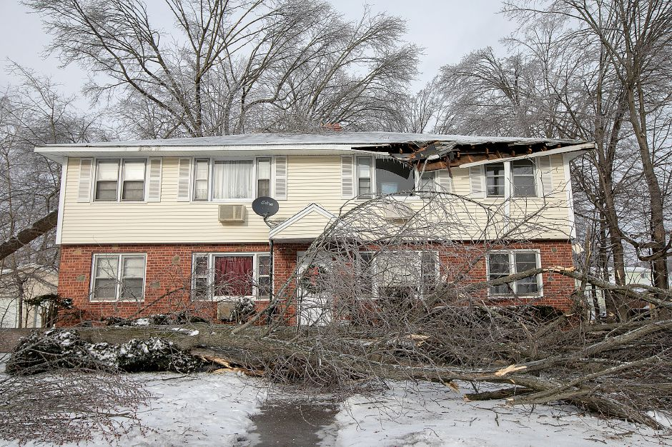 A fallen tree damaged this residence at 35 High St. in Wallingford, Mon. Jan. 21, 2019. Dave Zajac, Record-Journal