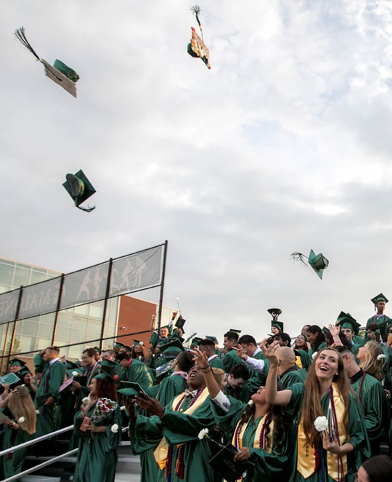 Graduates throw their caps at conclusion of graduation ceremonies at Maloney High School in Meriden, Tuesday, June 13, 2017. | Dave Zajac, Record-Journal