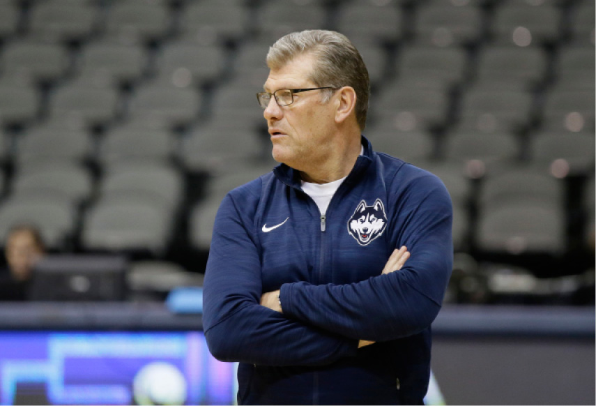 Connecticut head coach Geno Auriemma watches over his team a practice session for the women