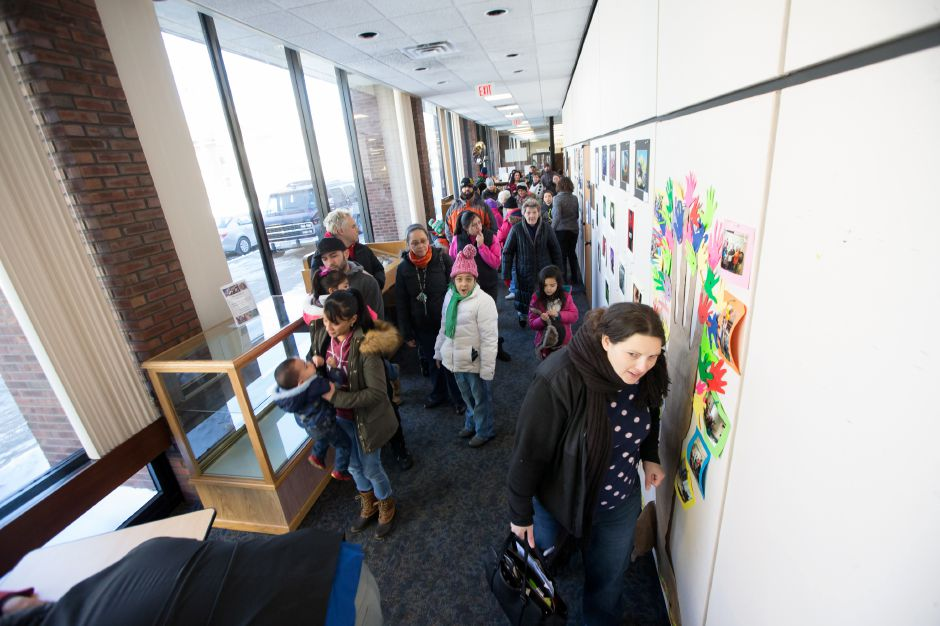 Parents and kids wait to see a program during the Three Kings Day celebration at the Meriden Public Library in January  2018.File photo,  Record-Journal