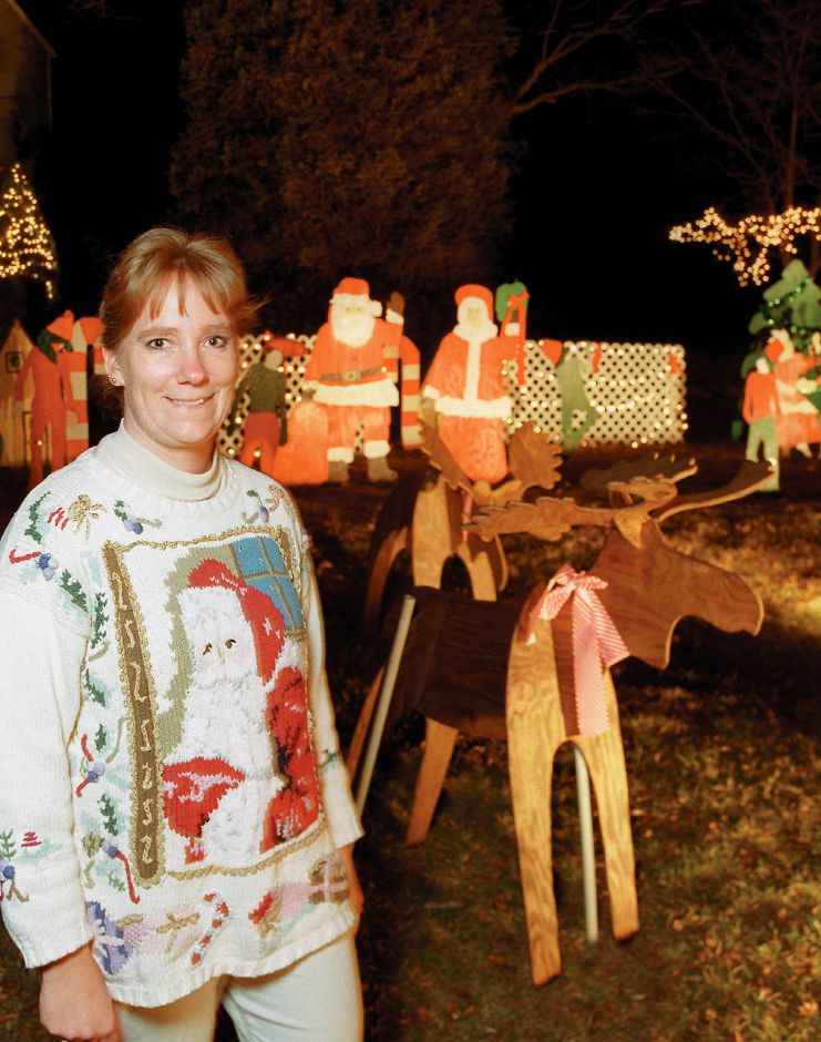 RJ file photo - Jessica English stands in her Southington yard decorated for the season, Dec. 1998.