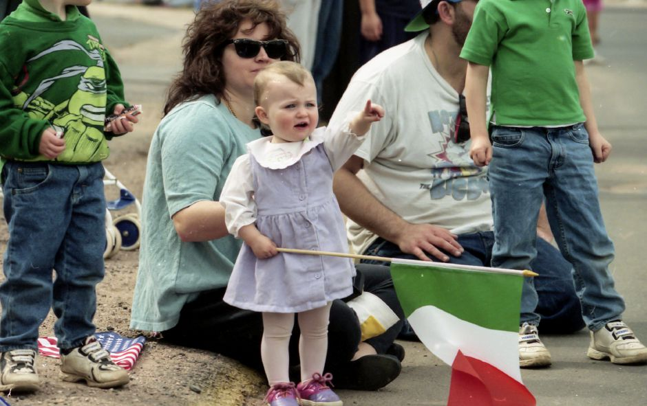 RJ file photo - Laura Gughran, 1, of Meriden, holds the Irish flag and points at the parade going down East Main Street in Meriden March 28, 1998. Behind her is her mother, Sue Gaughran.