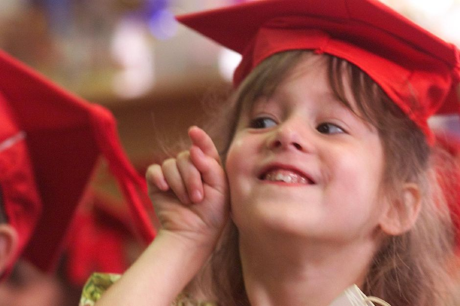 "Rachel Rimkoski,5 points to her family as she sits with her fellow pre-Kindergarten students during graduation exercises at ""I"