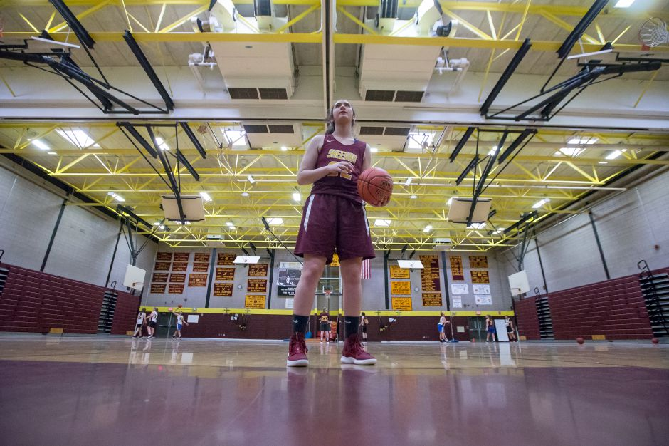 Senior Liv Robles takes a few foul shots during practice as she and the Sheehan Titans prep for Sunday's Class M state championship game with Cromwell at Mohegan Sun Arena. Opening tip is 3:30 p.m. | Justin Weekes / Special to the Record-Journal