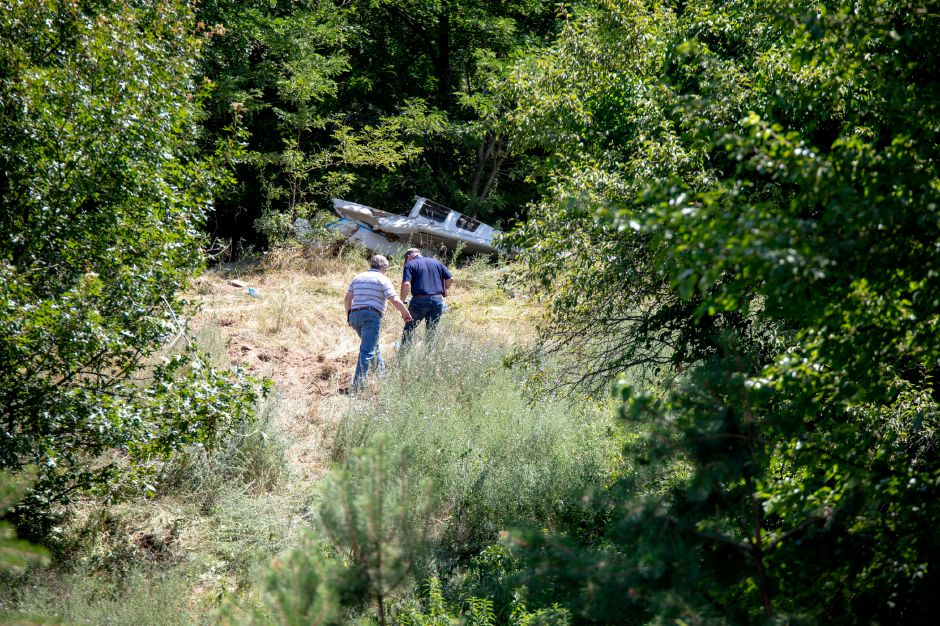 Investigators evaluate the scene of Thursday morning's plane crash near the Plainville Transfer Station. The pilot was ejected from the aircraft and died at the site, according to Plainville Police. Devin Leith-Yessian, Record-Journal