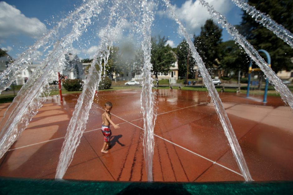 Lien Figueroa, 4, of Meriden, plays Monday at the Water Park in Meriden. Justin Weekes, Special to the Record-Journal