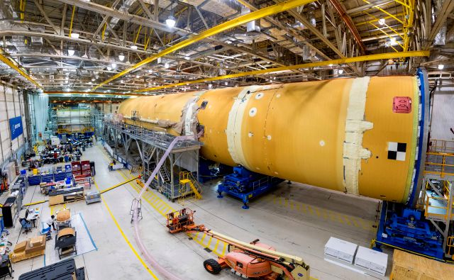 This August 2019 photo released by NASA, shows the core stage for NASA's Space Launch System (SLS) rocket at the agency's Michoud Assembly Facility in New Orleans. Kenneth Bowersox, acting associate administrator for human exploration, is casting doubt on the space agency