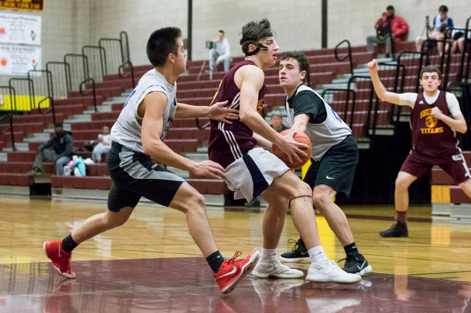 Sheehan's Garrett Molampy drives the lane Saturday during a scrimmage at Sheehan High School in Wallingford. Justin Weekes, special to the Record-Journal