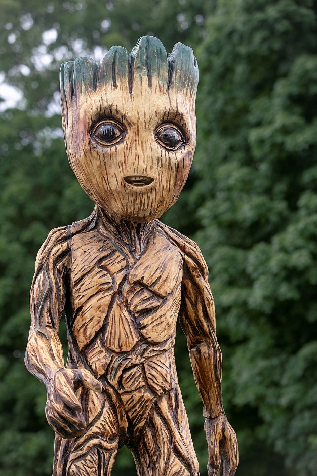 "A carving of the character Baby Groot from the superhero film ""Guardians of the Galaxy"" stands in the front yard of a residence on Cheshire Street in Cheshire, Wednesday, August 22, 2018. The work was carved in Massachusetts by artist Ken Packie and then installed atop the trunk of a maple tree for the homeowner. Dave Zajac, Record-Journal"