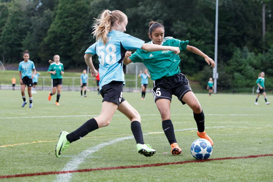 FILE – Wallingford Wolves Amy Casorla challenges for a ball Monday during the annual TWIST soccer tournament at Choate Rosemary Hall in Wallingford August 20, 2018 | Justin Weekes / Special to the Record-Journal