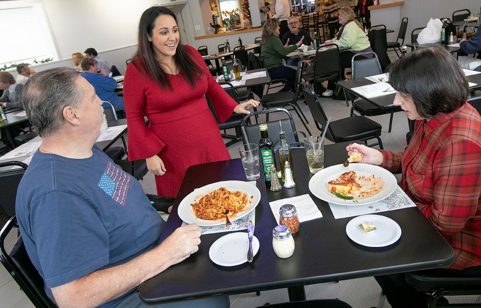 Marina Geraci visits with customers Jay and Debbie Dunn, of Southington, in the new Mamma Mia Restaurant at 1765 Meriden-Waterbury Turnpike in Southington on Friday. Geraci is the daughter of restaurant owner Luigi Camputaro. Photos by Dave Zajac, Record-Journal