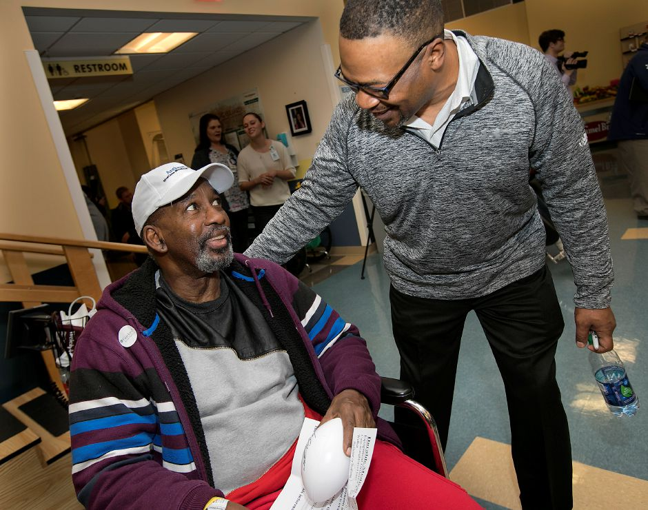Blair Thomas, a Penn State 1989 WCFF All-American, right, visits with patient Calvin Hayden, of New Haven, left, during Walter Camp day at Gaylord Specialty Healthcare in Wallingford, Friday, Jan. 12, 2018. Thomas also played for the New York Jets, New England Patriots and Dallas Cowboys. Dave Zajac, Record-Journal